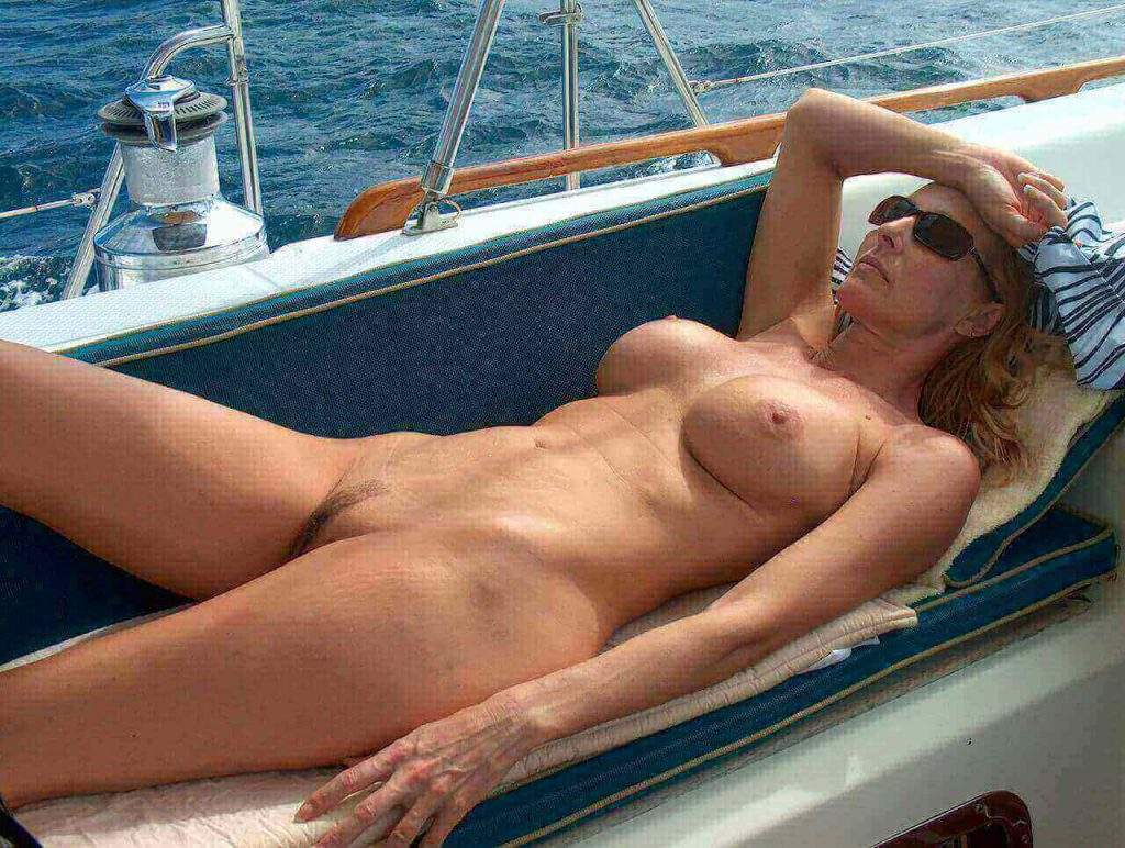 MILF nude on a boat